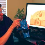Simplify3D - Jeremy at monitor holding model